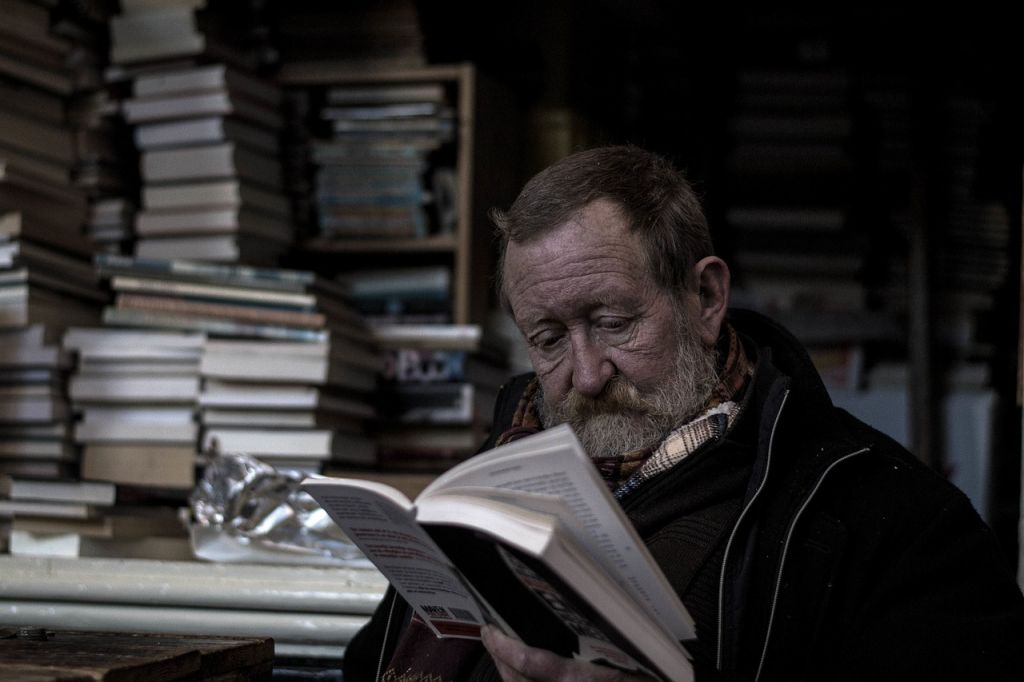 A man reading in a bookshop